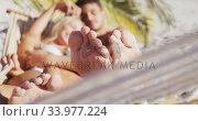 Caucasian couple lying on a hammock on the beach. Стоковое видео, агентство Wavebreak Media / Фотобанк Лори