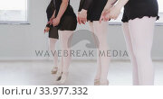 Купить «Caucasian female ballet dancers practicing a dance routine during a ballet class», видеоролик № 33977332, снято 24 октября 2019 г. (c) Wavebreak Media / Фотобанк Лори