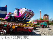Купить «Germany, Bremen - Showmen have set up a carousel for the TUEV acceptance», фото № 33983992, снято 23 апреля 2020 г. (c) Caro Photoagency / Фотобанк Лори
