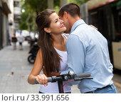 Купить «Romantic couple hugging and woman holding kick scooter», фото № 33991656, снято 13 августа 2019 г. (c) Яков Филимонов / Фотобанк Лори