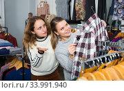 Women shopping in outerwear clothing boutique. Стоковое фото, фотограф Яков Филимонов / Фотобанк Лори