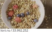 Купить «Top view of cooking healthy breakfast from falling fresh organic», видеоролик № 33992252, снято 7 июля 2020 г. (c) Ярослав Данильченко / Фотобанк Лори