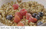 Купить «Cooking of healthy breakfast from falling granola, fresh organic», видеоролик № 33992272, снято 6 июля 2020 г. (c) Ярослав Данильченко / Фотобанк Лори