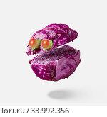 Купить «Cut red cabbage as a floating head with eyes from cherry tomatoes.», фото № 33992356, снято 12 июля 2020 г. (c) Ярослав Данильченко / Фотобанк Лори