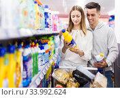 Купить «Happy couple buying household chemicals», фото № 33992624, снято 7 ноября 2019 г. (c) Яков Филимонов / Фотобанк Лори