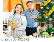 Купить «Couple quarreling at home», фото № 33992672, снято 13 июля 2020 г. (c) Яков Филимонов / Фотобанк Лори
