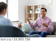 man and psychologist at psychotherapy session. Стоковое фото, фотограф Syda Productions / Фотобанк Лори