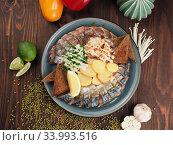 Herring fish with sliced potatoes and rye bread on a wooden table. Стоковое фото, фотограф Алексей Кокорин / Фотобанк Лори