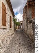 Narrow street in tourist ancient village of Lania, Cyprus (2019 год). Стоковое фото, фотограф Володина Ольга / Фотобанк Лори