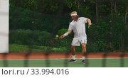 Купить «Tennis players playing a point», видеоролик № 33994016, снято 11 марта 2020 г. (c) Wavebreak Media / Фотобанк Лори