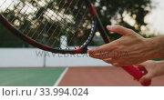 Купить «Tennis player adjusting racket rope», видеоролик № 33994024, снято 11 марта 2020 г. (c) Wavebreak Media / Фотобанк Лори