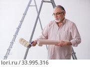 Купить «Old husband contractor in home renovation concept», фото № 33995316, снято 3 июня 2019 г. (c) Elnur / Фотобанк Лори