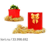 Купить «Christmas presents of red cover with golden ribbon. Isolated on a white background.», фото № 33998692, снято 14 июля 2020 г. (c) age Fotostock / Фотобанк Лори