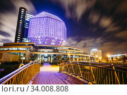 MINSK, BELARUS - SEPTEMBER 28, 2014: Unique Building Of National Library Of Belarus In Minsk At Night Scene. Building Has 23 Floors And Is 72-metre High... Стоковое фото, фотограф Ryhor Bruyeu / easy Fotostock / Фотобанк Лори