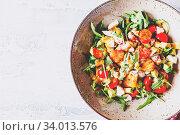 Купить «Green salad with avocado, cherry tomatoes and feta cheese. Healthy diet vegetarian summer vegetable salad. Table setting, food concept. Top view.», фото № 34013576, снято 6 июля 2020 г. (c) easy Fotostock / Фотобанк Лори