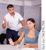 Купить «Husband scolding wife painting nails», фото № 34016704, снято 17 июля 2018 г. (c) Яков Филимонов / Фотобанк Лори