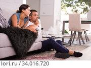 Happy couple watching tv at home. Стоковое фото, фотограф Яков Филимонов / Фотобанк Лори