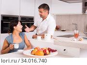 Couple having breakfast at home. Стоковое фото, фотограф Яков Филимонов / Фотобанк Лори