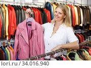 Купить «Portrait of nice woman customer with leather jackets in store», фото № 34016940, снято 5 сентября 2018 г. (c) Яков Филимонов / Фотобанк Лори