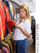 Купить «Woman choosing leather jacket», фото № 34017004, снято 5 сентября 2018 г. (c) Яков Филимонов / Фотобанк Лори