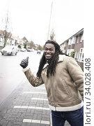 Happy man hitchhiking. Leeuwarden, Friesland, Netherlands, Europe. Стоковое фото, фотограф Egerland Productions / age Fotostock / Фотобанк Лори