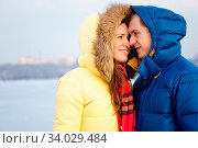 Couple smiling, huggingin winter in a forest. Стоковое фото, фотограф Zoonar.com/Sergey Mironov / easy Fotostock / Фотобанк Лори