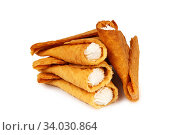 sweet buffet with rolled waffles with custard. Стоковое фото, фотограф Nataliia Zhekova / Фотобанк Лори