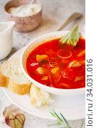 Купить «Borscht is a sour soup in Eastern Europe. Borsch includes beetroots», фото № 34031016, снято 20 марта 2019 г. (c) Nataliia Zhekova / Фотобанк Лори