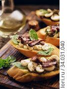 sandwich with mozzarella cheese, pesto, sun-dried tomatoes and basil and thyme. Стоковое фото, фотограф Nataliia Zhekova / Фотобанк Лори