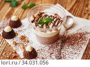 Купить «Italian dessert Panakota with on a wooden background. Creamy milk tender dessert in a glass.», фото № 34031056, снято 22 марта 2019 г. (c) Nataliia Zhekova / Фотобанк Лори