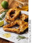 Купить «Carp baked in honey mustard sauce. Fried Slices of Big River Fish.», фото № 34031060, снято 22 марта 2019 г. (c) Nataliia Zhekova / Фотобанк Лори