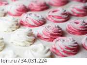 Купить «The process of making zephyr marshmallow at pastry shop kitchen. Fresh white and pink fruit marshmallow roses. Zephyr dusted with powdered sugar.», фото № 34031224, снято 13 февраля 2019 г. (c) Nataliia Zhekova / Фотобанк Лори