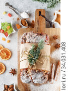 Stollen is fruit bread of nuts, spices, dried or candied fruit, coated with powdered sugar. It is traditional German bread eaten during the Christmas season. New year prep. Стоковое фото, фотограф Nataliia Zhekova / Фотобанк Лори