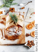 Stollen is a fruit bread of nuts, spices, and dried or candied fruit, coated with powdered sugar. It is a traditional German bread. Стоковое фото, фотограф Nataliia Zhekova / Фотобанк Лори