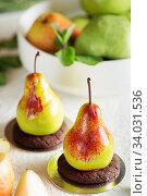 Купить «Mousse dessert in the shape of a pear fruit.», фото № 34031536, снято 4 февраля 2019 г. (c) Nataliia Zhekova / Фотобанк Лори