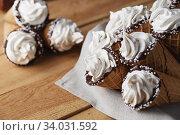 A lot of ice cream cones on wooden table. Soft ice creams or frozen custard in cones. Waffle marshmallows. Стоковое фото, фотограф Nataliia Zhekova / Фотобанк Лори