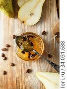 Купить «candied fruit jelly. pear marmalade with coffee beans. Jar of pear jam», фото № 34031688, снято 23 апреля 2019 г. (c) Nataliia Zhekova / Фотобанк Лори