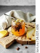Купить «candied fruit jelly. pear marmalade with coffee beans. Jar of pear jam», фото № 34031696, снято 23 апреля 2019 г. (c) Nataliia Zhekova / Фотобанк Лори