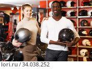 Купить «Couple holding purchased riding gear», фото № 34038252, снято 16 января 2019 г. (c) Яков Филимонов / Фотобанк Лори