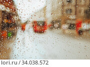 Купить «Raindrop on glass and red London bus lights blurry background.», фото № 34038572, снято 18 августа 2017 г. (c) Nataliia Zhekova / Фотобанк Лори