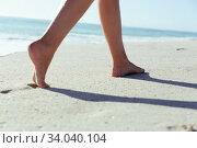 Купить «Feet of a Caucasian woman walking on sand and enjoying at beach», фото № 34040104, снято 25 февраля 2020 г. (c) Wavebreak Media / Фотобанк Лори