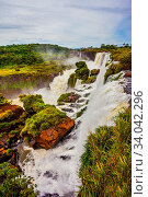 Купить «World of falling water. The waterfalls Iguazu. Picturesque basaltic ledges form the famous waterfalls. The concept of active and exotic tourism», фото № 34042296, снято 2 июля 2020 г. (c) easy Fotostock / Фотобанк Лори