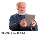 Funny shocked astonished old man using tablet computer, isolated on white. Стоковое фото, фотограф Zoonar.com/Serghei Starus / easy Fotostock / Фотобанк Лори