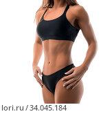 Купить «Slim sporty brunette wearing black top and briefs cropped isolated view on white», фото № 34045184, снято 14 июля 2020 г. (c) easy Fotostock / Фотобанк Лори