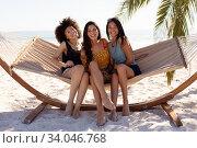 Купить «Multi ethnic group of female sitting on a hammock», фото № 34046768, снято 25 февраля 2020 г. (c) Wavebreak Media / Фотобанк Лори