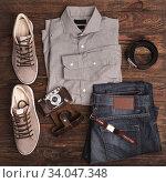 Купить «Hipster clothes and accessories on a wooden background», фото № 34047348, снято 15 января 2017 г. (c) Nataliia Zhekova / Фотобанк Лори