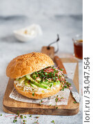 Купить «Healthy sandwich with bread, fresh avocado and cheese garnished with radish microgreens. Healthy eating concept. Avocado, ricotta cheese and radish sprouts on bun.», фото № 34047564, снято 22 января 2020 г. (c) Nataliia Zhekova / Фотобанк Лори