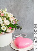 Купить «Gift set - pink heart-shaped mousse cake and a large bouquet of beautiful flowers on the grey grunge background. Valentine's Day. Mothers Day», фото № 34047608, снято 1 февраля 2020 г. (c) Nataliia Zhekova / Фотобанк Лори