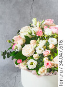 Купить «Bouquet of beautiful flowers with peonies, roses and eustomas in the papper gift box in front of grey grunge background. Closeup picture. Valentine's Day. Mothers Day», фото № 34047616, снято 1 февраля 2020 г. (c) Nataliia Zhekova / Фотобанк Лори