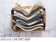 kitchen textile. stack of fabrics in different colors and textures, close-up. Kitchen towels on white background. Many fabric kitchen napkins in a wicker basket. Props for foodphotography. Стоковое фото, фотограф Nataliia Zhekova / Фотобанк Лори